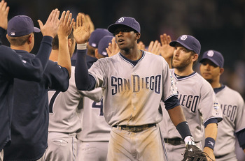SEATTLE - JULY 02:  Cameron Maybin #24 (C) of the San Diego Padres celebrates with teammates after defeating the Seattle Mariners 1-0 at Safeco Field on July 2, 2011 in Seattle, Washington. (Photo by Otto Greule Jr/Getty Images)