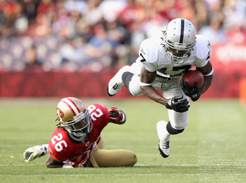 SAN FRANCISCO, CA - AUGUST 20:  Denarius Moore #17 of the Oakland Raiders is tripped up by Tramaine Brock #26 of the San Francisco 49ers at Candlestick Park on August 20, 2011 in San Francisco, California.  (Photo by Ezra Shaw/Getty Images)