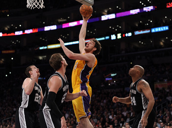 LOS ANGELES, CA - APRIL 12:  Pau Gasol #16 of the Los Angeles Lakers shoots a jump hooks in front of Steve Novak #23, Tiago Splitter #22 and Richard Jefferson #24 of the San Antonio Spurs at Staples Center on April 12, 2011 in Los Angeles, California.  NO