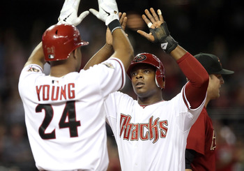 PHOENIX, AZ - AUGUST 09:  Justin Upton #10 of the Arizona Diamondbacks high fives teammate Chris Young #24 after Upton scored a run against the Houston Astros during the first inning of the Major League Baseball game at Chase Field on August 9, 2011 in Ph