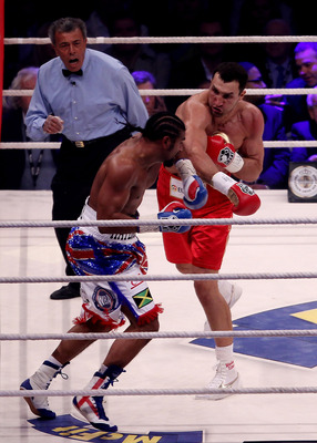 HAMBURG, GERMANY - JULY 02:  Wladimir Klitschko of the Ukraine attemps a right hook to David Haye of England during their heavy weight unification match at the Imtech Arena on July 2, 2011 in Hamburg, Germany.  (Photo by Scott Heavey/Getty Images)