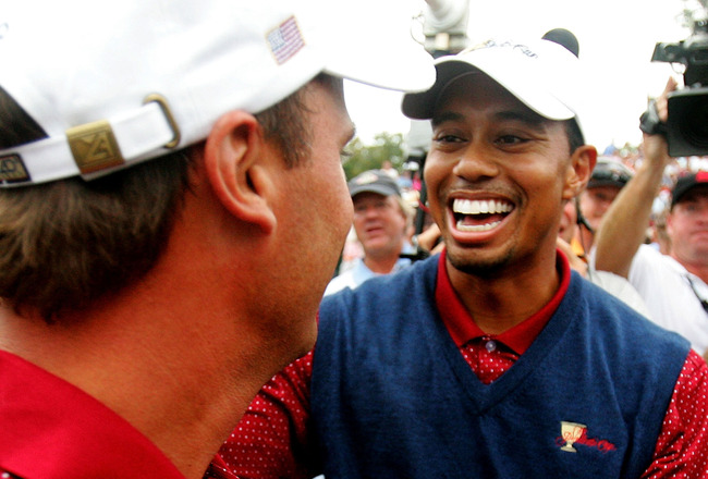 GAINESVILLE, VA - SEPTEMBER 25:  USA team member Tiger Woods congratulates teammate Chris DiMarco after winning his match during the Sunday Singles Matches at the 2005 Presidents Cup on September 25, 2005 at Robert Trent Jones Golf in Gainesville, Virgini