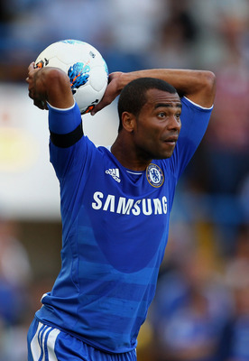 LONDON, ENGLAND - AUGUST 20:  Ashley Cole of Chelsea takes a throw in of Chelsea looks on during the Barclays Premier League match between Chelsea and West Bromwich Albion at Stamford Bridge on August 20, 2011 in London, England.  (Photo by Julian Finney/