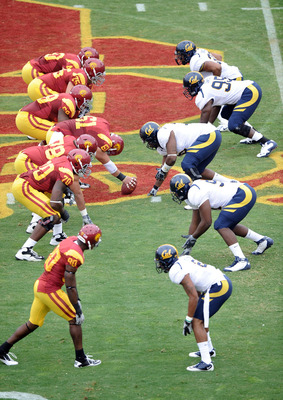 LOS ANGELES, CA - OCTOBER 16:  The USC Trojans and California Golden Bears line up for a snap at Los Angeles Memorial Coliseum on October 16, 2010 in Los Angeles, California.  (Photo by Harry How/Getty Images)