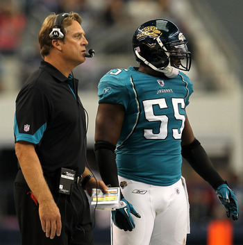 ARLINGTON, TX - OCTOBER 31:  Head coach Jack Del Rio and Kirk Morrison #55 of the Jacksonville Jaguars look on from the sideline against the Dallas Cowboys at Cowboys Stadium on October 31, 2010 in Arlington, Texas.  (Photo by Stephen Dunn/Getty Images)