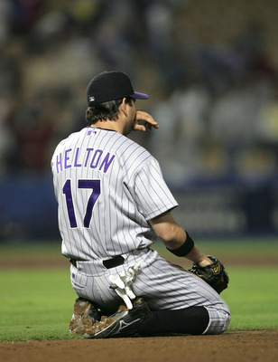 LOS ANGELES - SEPTEMBER 28:  First baseman Todd Helton #17 of the Colorado Rockies lingers on his knees after he was unsuccessful in his diving attemt to stop the game winning single by Steve Finley of the Los Angeles Dodgers on September 28, 2004 at Dodg