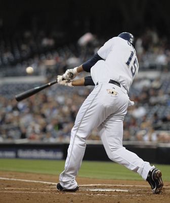 SAN DIEGO, CA - AUGUST 18:  Jesus Guzman #15 of the San Diego Padres hits an RBI triple during the first inning of a baseball game against the Florida Marlins at Petco Park on August 18, 2011 in San Diego, California. The Padres won 3-1.  (Photo by Denis
