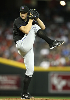 PHOENIX, AZ - AUGUST 14:  Starting pitcher Chris Capuano #38 of the New York Mets pitches against the Arizona Diamondbacks during the Major League Baseball game at Chase Field on August 14, 2011 in Phoenix, Arizona.  The Diamondbacks defeated the Mets 5-3