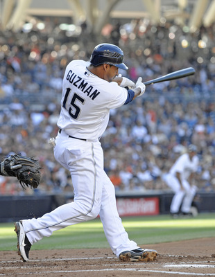 SAN DIEGO, CA - JULY 16: Jesus Guzman #15 of the San Diego Padres hits a three-run homer during the first inning of a baseball game against the San Francisco Giants at Petco Park on July 16, 2011 in San Diego, California. (Photo by Denis Poroy/Getty Image