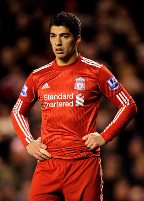 LIVERPOOL, ENGLAND - FEBRUARY 02:  Luis Suarez of Liverpool looks on during the Barclays Premier League match between Liverpool and Stoke City at Anfield on February 2, 2011 in Liverpool, England.  (Photo by Michael Regan/Getty Images)