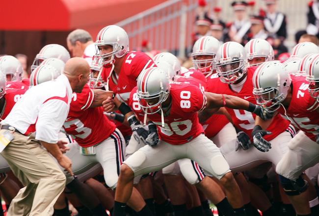 COLUMBUS, OH - SEPTEMBER 27: The Ohio State Buckeyes get fired up before taking the field for pre-game warm-ups prior to their game against the Minnesota Golden Gophers on September 27, 2008 at Ohio Stadium in Columbus, Ohio.  (Photo by Jamie Sabau/Getty