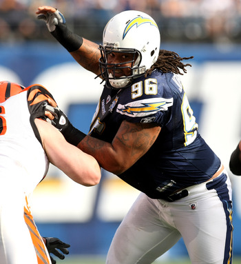 SAN DIEGO - DECEMBER 20: Defensive lineman Travis Johnson #96 of the San Diego Chargers battles at the line against the Cincinnati Bengals on December 20, 2009 at Qualcomm Stadium in San Diego, California.    (Photo by Stephen Dunn/Getty Images)