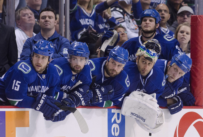 VANCOUVER, CANADA - MAY 7: (from left) Tanner Glass #15, team trainer Mike Burnstein, Dan Hamhuis #2, Aaron Rome #29, goalie Roberto Luongo #1, Kevin Bieksa #3 and Sami Salo #6 of the Vancouver Canucks watch the final minute of play of the third period in