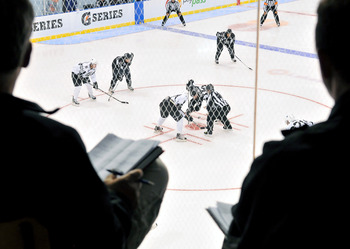 TORONTO, ON - AUGUST 18: NHL scouts watch an on-ice session where new faceoff locations were tested during the 2010 NHL Research, Development and Orientation Camp fueled by G Series on August 18, 2010 in Toronto, Canada.  (Photo by Matthew Manor/Getty Ima
