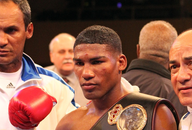 ATLANTIC CITY, NJ - MARCH 26: Yuriorkis Gamboa wears the championship belt after winning the IBF WBA World Featherweight title by beating Jorge Solis of Mexico during Top Rank's 'Featherweight Fury' on March 26, 2011 at Boardwalk Hall in Atlantic City, Ne