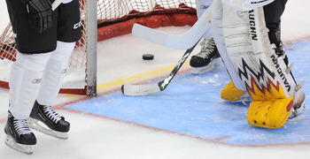 TORONTO, ON - AUGUST 18: A puck is retrieved from the net where the NHL tested a yellow verification line located behind the goal line, as part of the 2010 NHL Research, Development and Orientation Camp at the Mastercard Center on August 18, 2010 in Toron