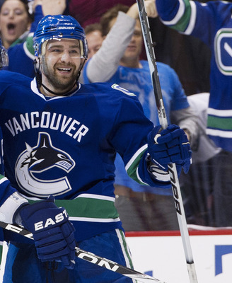 VANCOUVER, CANADA - APRIL 28: Chris Higgins #20 (R) celebrates with Dan Hamhuis #2 of the Vancouver Canucks after scoring against the Nashville Predators during the second period in Game One of the Western Conference Semifinals during the 2011 NHL Stanley