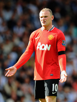 WEST BROMWICH, ENGLAND - AUGUST 14:  Wayne Rooney of Manchester United gestures during the Barclays Premier League match between West Bromwich Albion and Manchester United at The Hawthorns on August 14, 2011 in West Bromwich, England.  (Photo by Mike Hewi