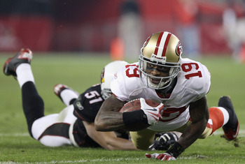 GLENDALE, AZ - NOVEMBER 29:  Wide receiver Ted Ginn Jr. #19 of the San Francisco 49ers dives for extra yards after a reception past Paris Lenon #51 of the Arizona Cardinals during the NFL game at the University of Phoenix Stadium on November 29, 2010 in G