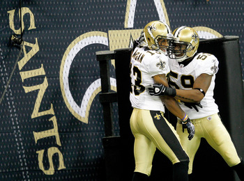 NEW ORLEANS, LA - AUGUST 12: Joeseph Morgan # 13 of the New Orleans Saints celebrates with teammate Nate Bussey # 59 after scoring on a punt return aginst the San Francisco 49ers during their pre season game at Louisiana Superdome on August 12, 2011 in Ne