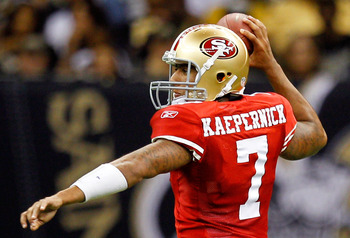 NEW ORLEANS, LA - AUGUST 12: Colin Kaepernick # 7 of the San Francisco 49ers defends as his team plays the New Orleans Saints during their pre season game at Louisiana Superdome on August 12, 2011 in New Orleans, Louisiana.  (Photo by Sean Gardner/Getty I