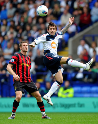 Manchester City's James Milner, left, and Bolton's Mark Davies