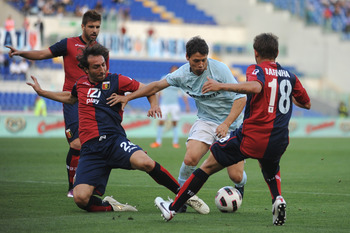 ROME, ITALY - MAY 14:  Mauro Matias Zarate of SS Lazio in action against Emiliano Moretti (L) and Rafinha Ferreira (R) of Genoa CFC during the Serie A match between SS Lazio and Genoa CFC at Stadio Olimpico on May 14, 2011 in Rome, Italy.  (Photo by Valer