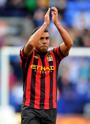 BOLTON, ENGLAND - AUGUST 21:  Carlos Tevez  of Manchester City applauds the fans at the end of the Barclays Premier League match between Bolton Wanderers and Manchester City at the Reebok Stadium on August 21, 2011 in Bolton, England.  (Photo by Michael R