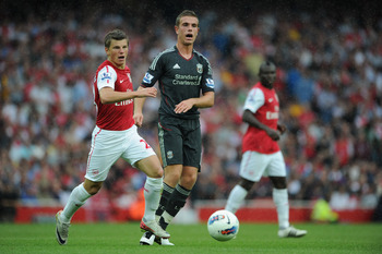 LONDON, ENGLAND - AUGUST 20:  Andrey Arshavin of Arsenal and Jordan Henderson of Liverpool in action during the Barclays Premier League match between Arsenal and Liverpool at the Emirates Stadium on August 20, 2011 in London, England.  (Photo by Michael R