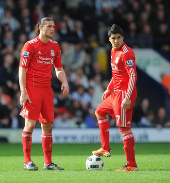 WEST BROMWICH, ENGLAND - APRIL 02:  Andy Carroll and Luis Suarez of Liverpool look dejected after the first West Brom goal during the Barclays Premier League match between West Bromwich Albion and Liverpool at The Hawthorns on April 2, 2011 in West Bromwi
