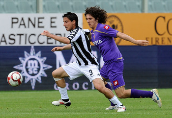 FLORENCE, ITALY - MAY 09:  Cristiano Del Grosso of Siena and Stevan Jovetic of Fiorentina in action during the Serie A match between ACF Fiorentina and AC Siena at Stadio Artemio Franchi on May 9, 2010 in Florence, Italy.  (Photo by Giuseppe Bellini/Getty