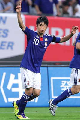 SAPPORO, JAPAN - AUGUST 10:  Shinji Kagawa of Japan celebrates his goal against South Korea during the Kirin Challenge Cup international friendly match between Japan and South Korea at Sapporo Dome on August 10, 2011 in Sapporo, Japan.  (Photo by Kiyoshi