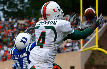 DURHAM, NC - OCTOBER 18:  Receiver Aldarius Johnson #4 of the Miami Hurricanes pulls in this touchdown reception against Glenn Williams #24 of the Duke Blue Devils during the game at Wallace Wade Stadium on October 18, 2008 in Durham, North Carolina.  (Ph