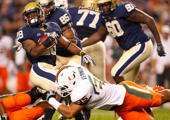 PITTSBURGH - SEPTEMBER 23:  Dion Lewis #28 of the Pittsburgh Panthers is tackled by Olivier Vernon #35 of the Miami Hurricanes on September 23, 2010 at Heinz Field in Pittsburgh, Pennsylvania.  (Photo by Jared Wickerham/Getty Images)