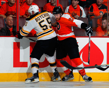 PHILADELPHIA, PA - MAY 02:  Johnny Boychuk #55 of the Boston Bruins checks Claude Giroux #28 of the Philadelphia Flyers during Game Two of the Eastern Conference Semifinals during the 2011 NHL Stanley Cup Playoffs at Wells Fargo Center on May 2, 2011 in P