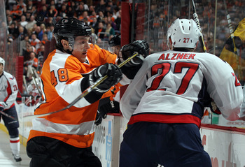 PHILADELPHIA, PA - JANUARY 18: Danny Briere #48 of the Philadelphia Flyers attempts to hit Karl Alzner #27 of the Washington Capitals at the Wells Fargo Center on January 18, 2011 in Philadelphia, Pennsylvania.  (Photo by Bruce Bennett/Getty Images)