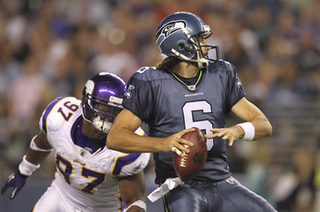 SEATTLE - AUGUST 20:  Quarterback Charlie Whitehurst #6 of the Seattle Seahawks looks to pass under pressure from Everson Griffen #97 of the Minnesota Vikings at CenturyLink Field on August 20, 2011 in Seattle, Washington. The Vikings defeated the Seahawk