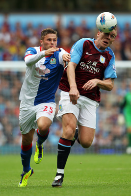 BIRMINGHAM, ENGLAND - AUGUST 20:  Richard Dunne of Aston Villa battle for the ball with David Goodwillie of Blackburn during the Barclays Premier League match between Aston Villa and Blackburn Rovers at Villa Park on August 20, 2011 in Birmingham, England
