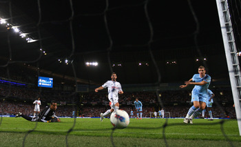 MANCHESTER, ENGLAND - AUGUST 15:  Edin Dzeko of Manchester City scores the opening goal during the Barclays Premier League match between Manchester City and Swansea City at Etihad Stadium on August 15, 2011 in Manchester, England.  (Photo by Alex Livesey/