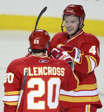 CALGARY, CANADA - APRIL 6: Greg Nemisz #48 celebrates his first point in the NHL on an assist to the goal by Curtis Glencross #20 of the Calgary Flames against the Edmonton Oilers in third period NHL action on April 6, 2011 at the Scotiabank Saddledome in