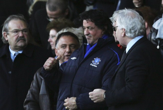 LIVERPOOL, UNITED KINGDOM - JANUARY 14:  Hollywood Actor Sylvester Stallone celebrates the equalising goal with Everton shareholder Robert Earl (L) and Chairman Bill Kenwright as they watch the action during the Barclays Premiership match between Everton