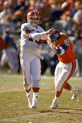 1989:  Quarterback Bernie Kosar #19 of the Cleveland Browns passes during the 1989 AFC Championship game against the Denver Broncos at Mile High Stadium in Denver, Colorado.  The Broncos defeated the Browns 37-21. (Photo by Tim DeFrisco/Getty Images)