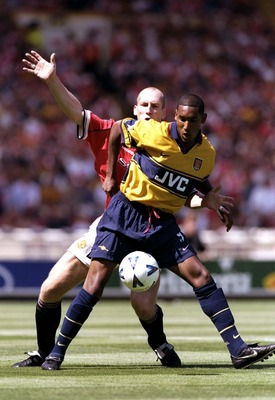 9 Aug 1998:  Nicolas Anelka of Arsenal holds off Jaap Stam of Manchester United during the FA Charity Shield match at Wembley Stadium in London. Arsenal won 3-0.  \ Mandatory Credit: Ben Radford /Allsport
