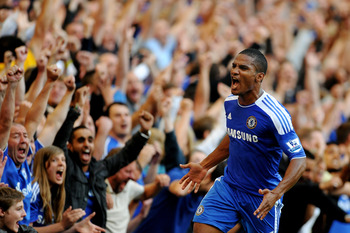 Florent Malouda celebrates after scoring Chelsea's winner at Stamford Bridge