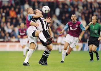 23 Sep 2001:  Tomas Repka of West Ham gets to grips with Alan Shearer of Newcastle during the FA Barclaycard Premiership match between West Ham United and Newcastle United played at Upton park in London.  West Ham won the match 3 - 0. \ Mandatory Credit:J