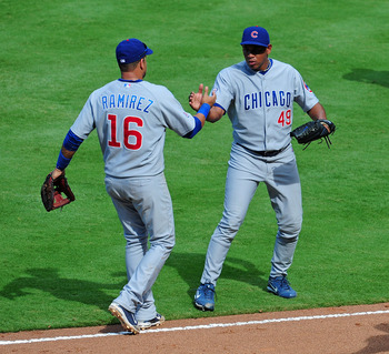 ATLANTA - AUGUST 14: Carlos Marmol #49 and Aramis Ramirez #16 of the Chicago Cubs celebrate after the game against the Atlanta Braves at Turner Field on August 14, 2011 in Atlanta, Georgia. (Photo by Scott Cunningham/Getty Images)