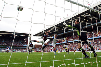 Morten Gamst Pederson heads past Aston Villa goalkeeper Shay Given, but it was only a consolation goal
