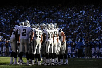 SAN DIEGO - NOVEMBER 01:  JaMarcus Russell #2 of the Oakland Raiders holds a huddle against the San Diego Chargers during the game at Qualcomm Stadium on November 1, 2009 in San Diego California. The Chargers defeated the Raiders 24-16. (Photo by Harry Ho