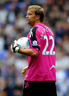 BOLTON, ENGLAND - AUGUST 21:   Jussi Jaaskelainen of Bolton Wanderers looks on during the Barclays Premier League match between Bolton Wanderers and Manchester City at the Reebok Stadium on August 21, 2011 in Bolton, England.  (Photo by Laurence Griffiths