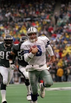 26 Oct 1997:  Quarterback Troy Aikman of the Dallas Cowboys moves the ball during a game against the Philadelphia Eagles at Veterans Stadium in Philadelphia, Pennsylvania.  The Eagles won the game, 13-12. Mandatory Credit: Ezra O. Shaw  /Allsport